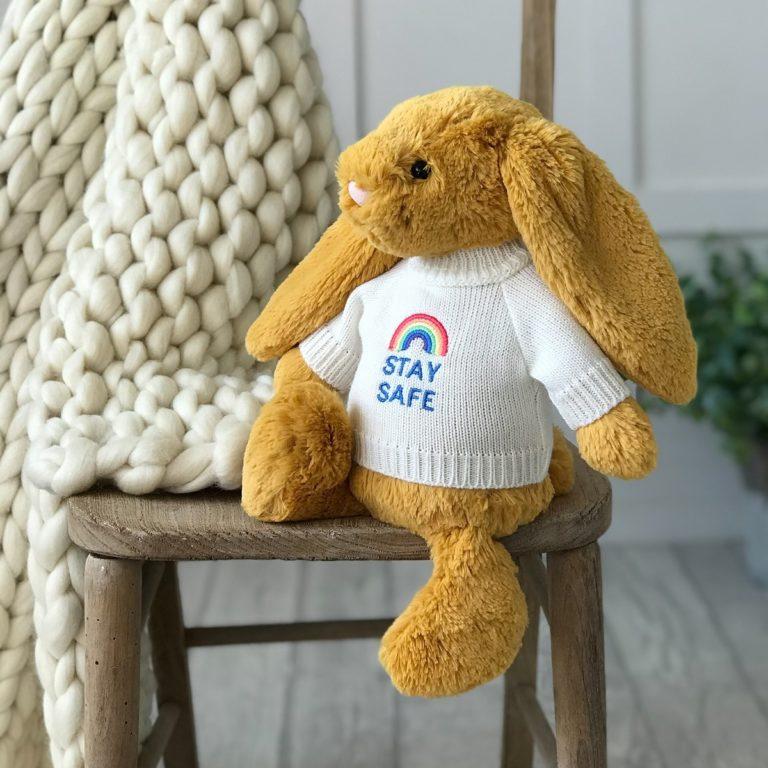 Jellycat medium bashful bunny soft toy with 'Stay Safe' jumper in Saffron